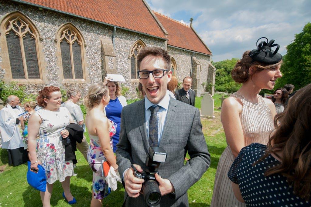 Hertfordshire Wedding Photographer - wedding guest with camera