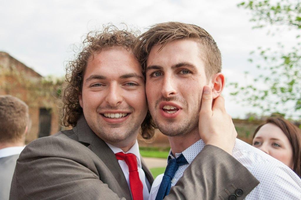 Hertfordshire Wedding Photographer - wedding guests hugging