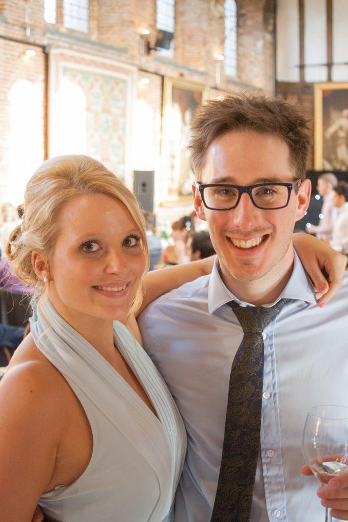 Hertfordshire Wedding Photographer - wedding guest and bridesmaid hugging