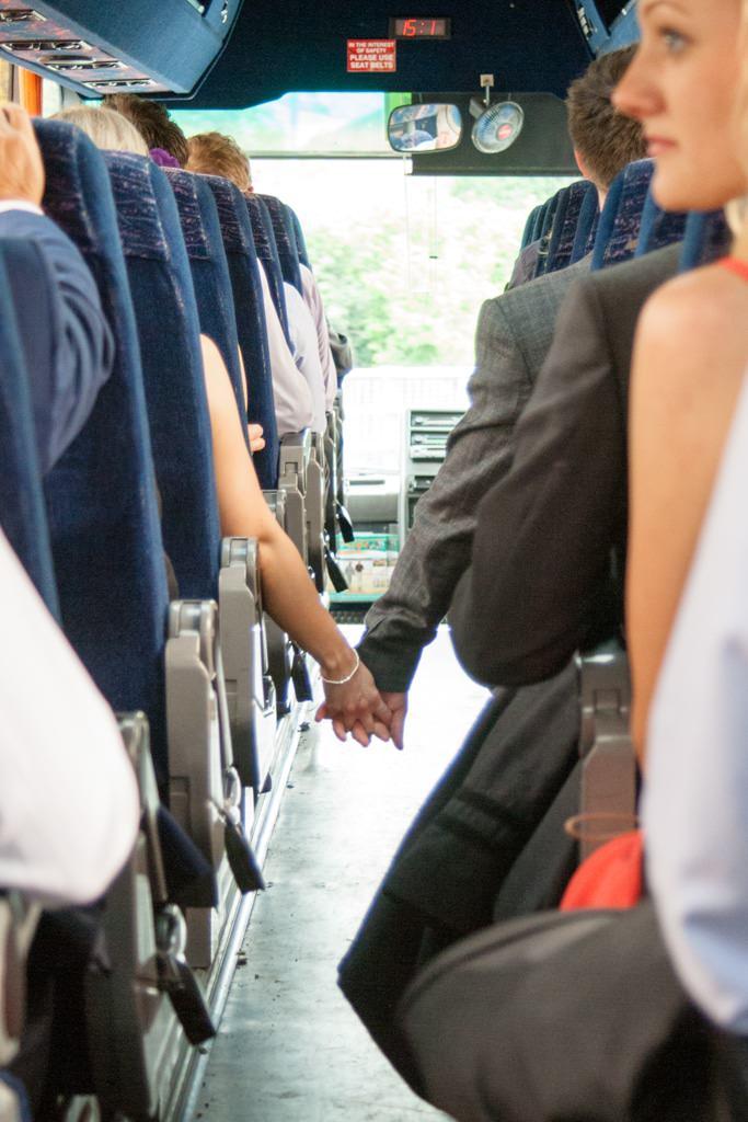 Hertfordshire Wedding Photographer - wedding guests holding hands