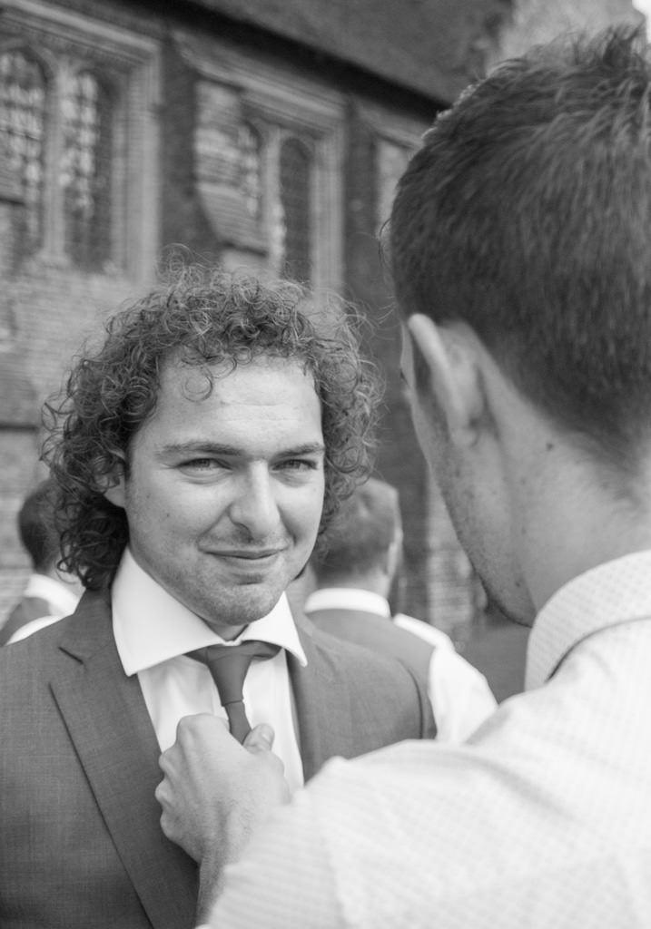 Hertfordshire Wedding Photographer - helping wedding guest black and white