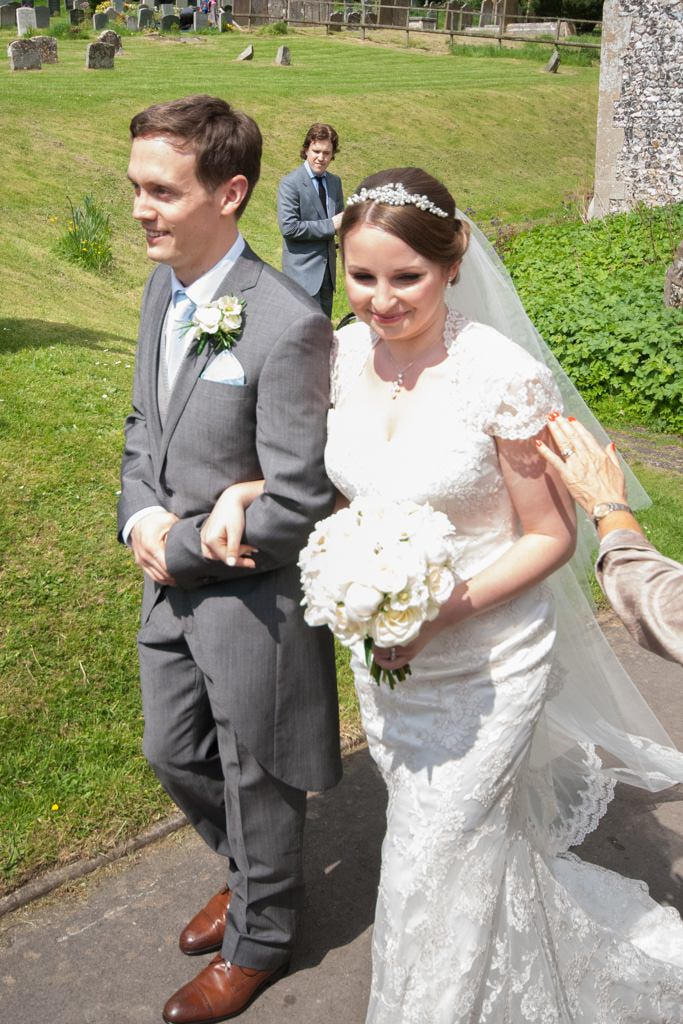 Hertfordshire Wedding Photographer - bride and groom exiting the church