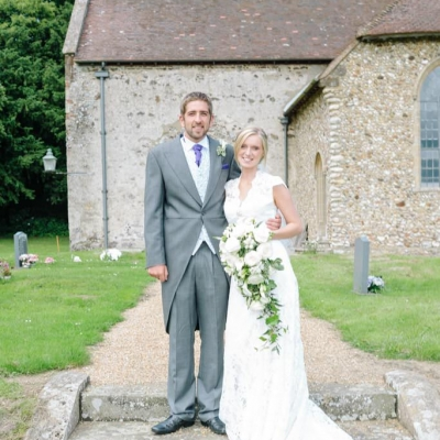 Norfolk wedding photographer – bride and groom outside church