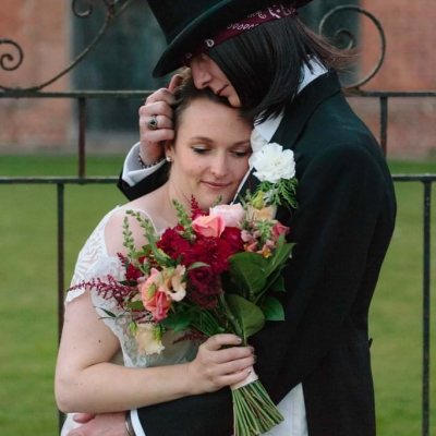 Norfolk wedding photographer – bride and groom cuddle