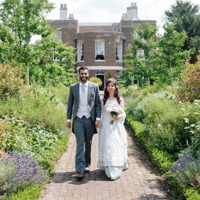 Norfolk wedding photographer – bride and groom walking in garden