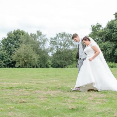 Norfolk wedding photographer – wedding couple walking