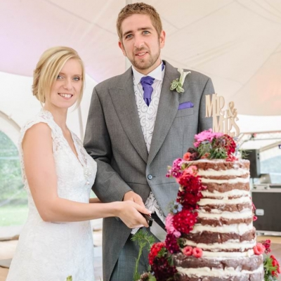 Norfolk wedding photographer – bride and groom cutting cake