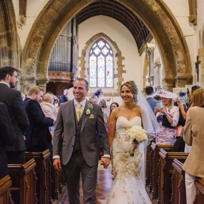 Norfolk wedding photographer – bride and groom leaving church