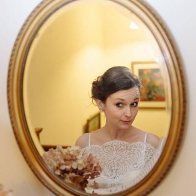 Norfolk wedding photographer – bride looking in the mirror
