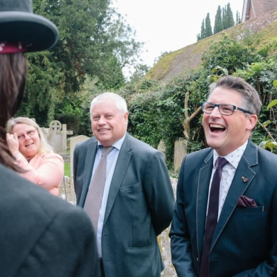 Norfolk wedding photographer – laughing with groom
