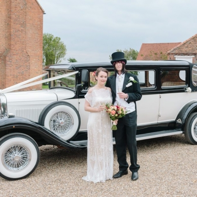 Norfolk wedding photographer – bride and groom wedding car lillibrooke manor