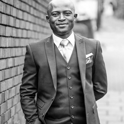 Norfolk wedding photographer – groom suit black and white