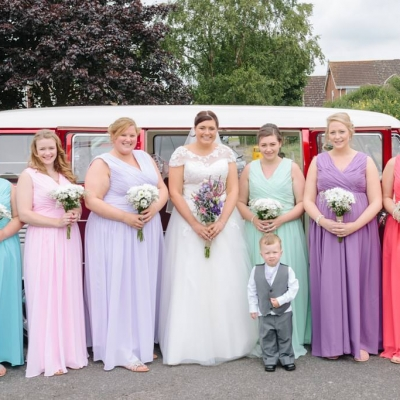 Norfolk wedding photographer – bride and bridesmaids with wedding car