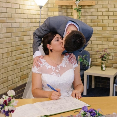 Norfolk wedding photographer – bride and groom kissing