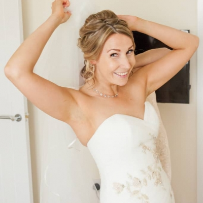 Norfolk wedding photographer – bride putting in veil