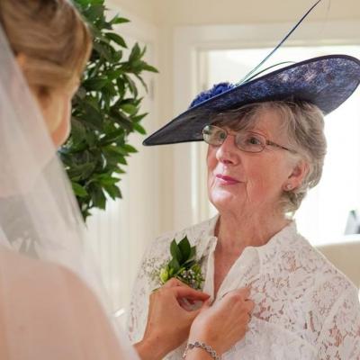 Norfolk wedding photographer – bride helping mother