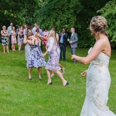 Norfolk wedding photographer – bride throwing bouquet