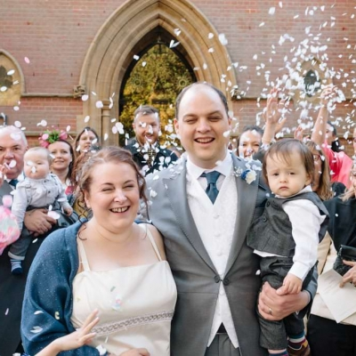 Norfolk wedding photographer – bride and groom confetti