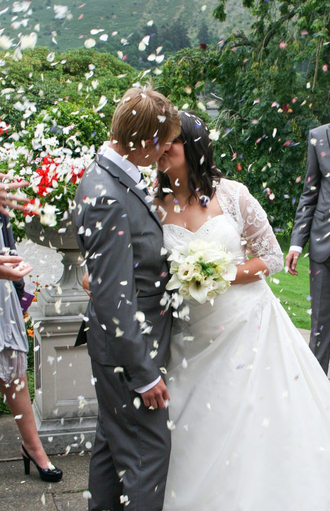 Cumbria Wedding Photographer - bride and groom confetti