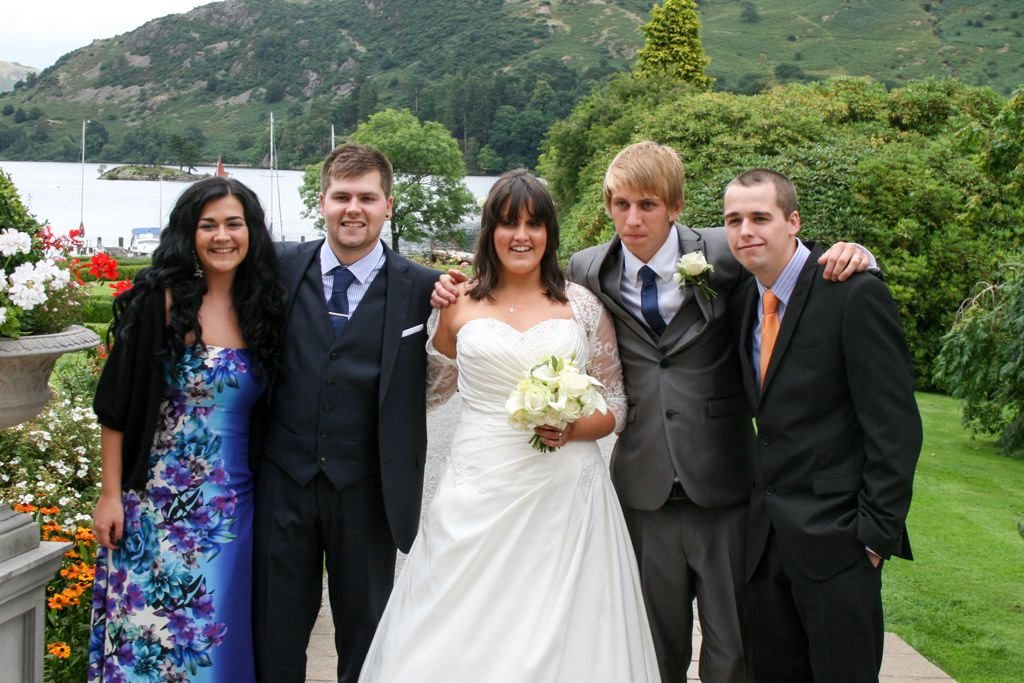 Cumbria Wedding Photographer - bride and groom with friends