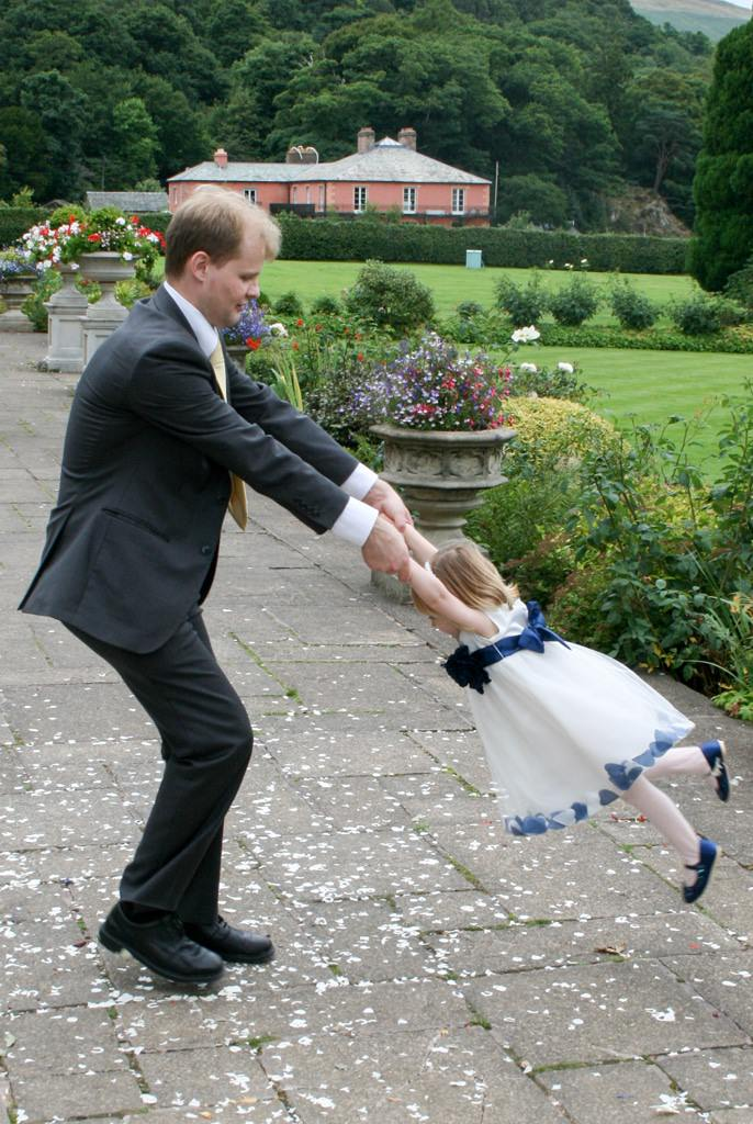 Cumbria Wedding Photographer - flower girl and dad playing