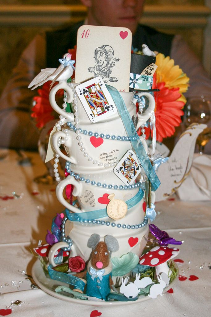 Cumbria Wedding Photographer - Alice in Wonderland tea cups stacked high decorated