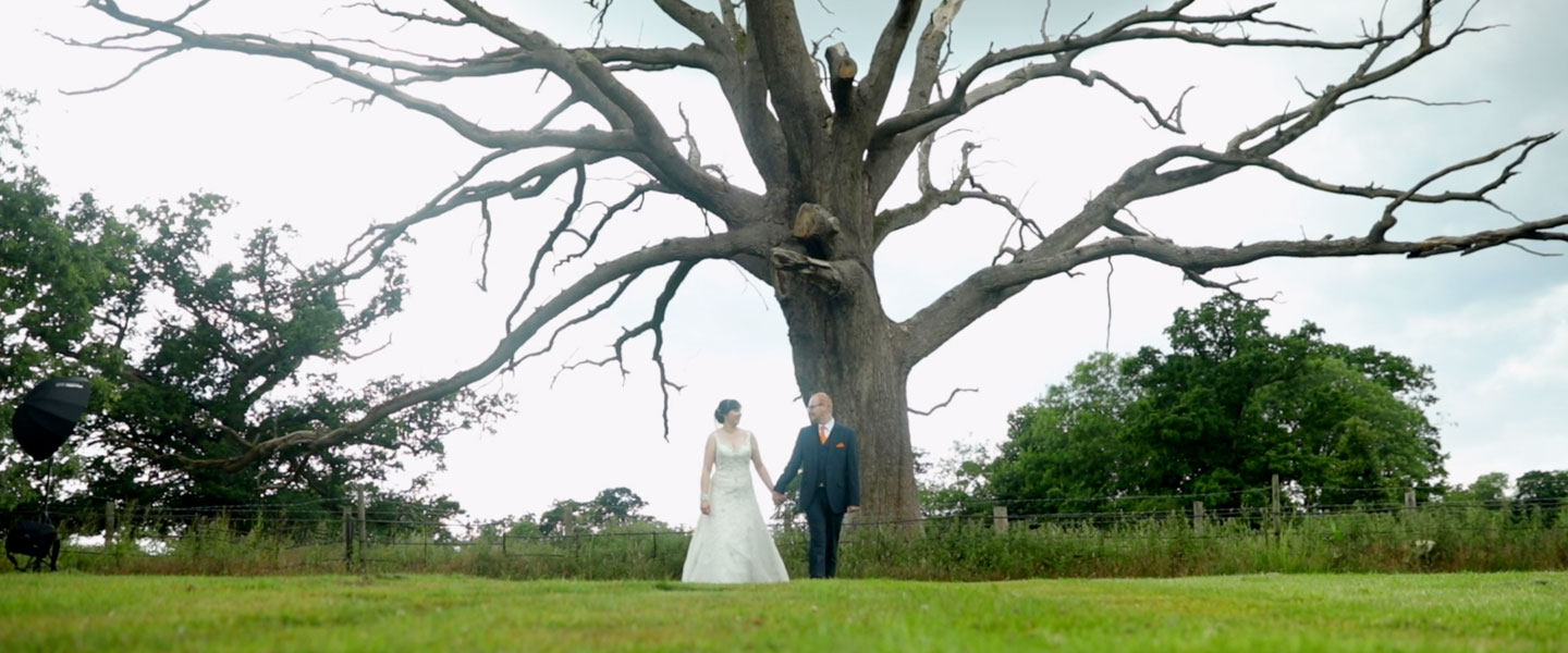 Wedding Couple Walking Under Tree At Congham Hall